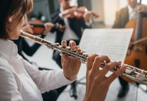 Flutist playing her instrument on stage 9jdgtc6%20(2)