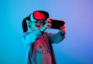 Teenage kid playing with vr virtual reality pagwc5j%20(2)