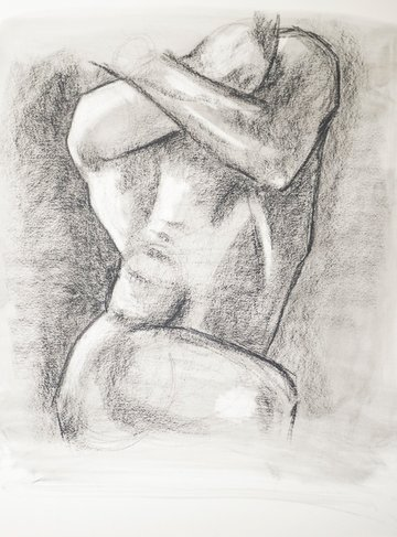 Darken in the background of your charcoal sketch