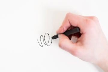 holding charcoal like a pencil