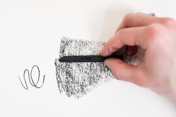 holding charcoal on its side