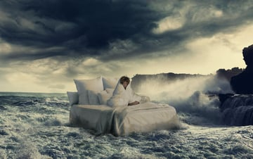 sprinkling water around the bed