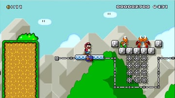 A Mario level with a moving platform spikes and multiple enemies