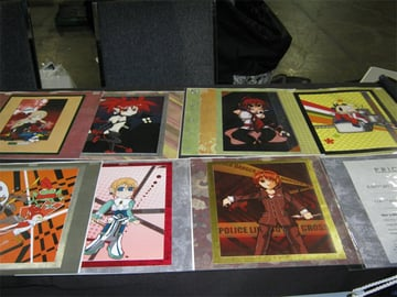 Prints and a price list on Leahs table from Anime North 2012