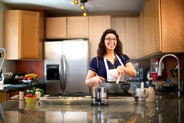Woman cooking in a kitchen