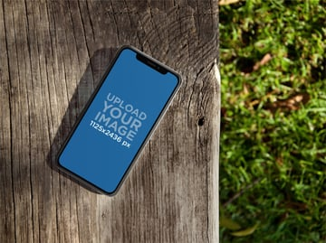 iPhone X Mockup Lying on a Wooden Bench Outdoors