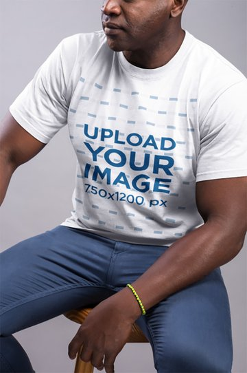 T-Shirt Mockup Featuring Man Wearing a Yellow and Green Bracelet