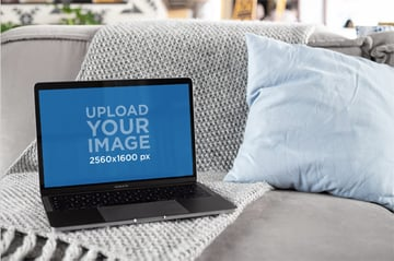 MacBook Mockup Featuring a House Environment