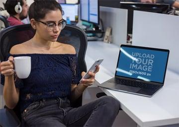 MacBook Mockup Featuring a Woman Taking a Break