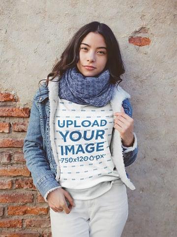 Mockup of a Woman Wearing a Sweatshirt and a Denim Jacket