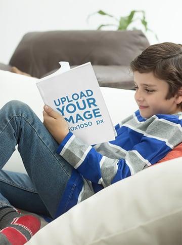 Boy Reading a Book Mockup at the Studio