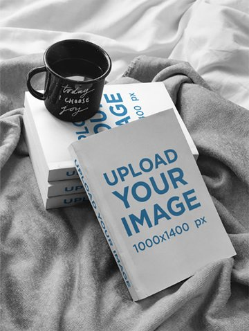 Cup of Coffee Over Books Mockup on a Bed
