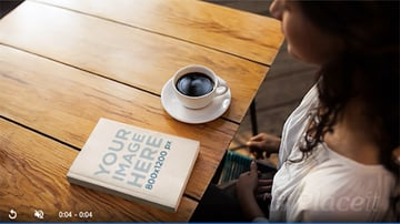 Ebook Stop Motion of a Girl Having A Coffee While Book Lying On Table
