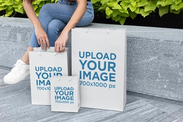 Gift Bags Mockup Featuring a Woman on a Bench