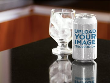 Label Mockup Featuring a Soda Can Next to a Glass With Ice