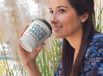 Label Mockup Featuring a Woman Drinking Coffee From a Takeaway Cup