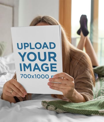 Magazine Mockup Template of a Woman Reading in Bed