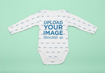 Mockup of a Onesie Laid Flat on a Surface