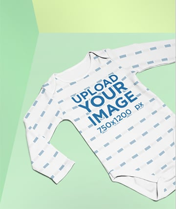 Mockup of a Sublimated Onesie Lying on a Split Colored Background