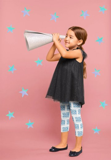 Mockup of a Cute Child Wearing Leggings and Pretending to Be Stargazing