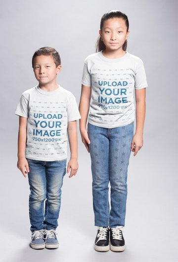 Asian Kids Wearing T-Shirts Mockup in a White Room