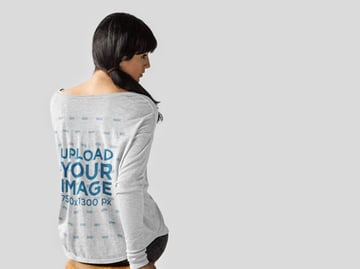 Back of a Woman Wearing a Bella Flowie Slouchy Tee Mockup Facing a White Backdrop