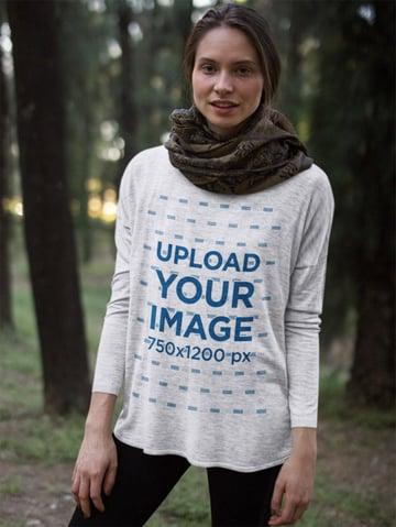 Woman Wearing a Bella Flowie Canvas Long Sleeve Tee Mockup in the Woods