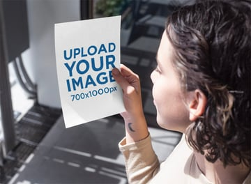 Mockup Featuring a Woman Looking at an A5 Flyer