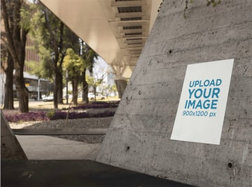 Poster on a Concrete Structure Below a Bridge in the City Mockup