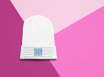 Flat Lay Mockup of a Cuffed Beanie on a Surface with Three Colors