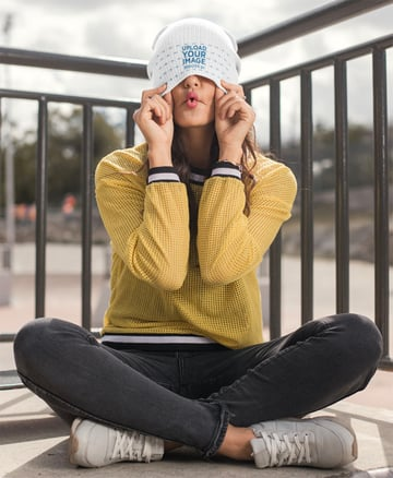 Mockup of a Woman Hiding Her Face with Her Beanie