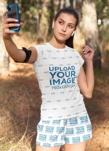 T-Shirt and Shorts Mockup of a Woman Taking a Selfie