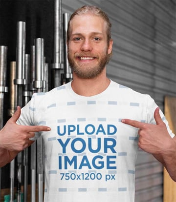 Mockup of a Man Showing His Sublimated Tee in Front of the Bars at a Gym