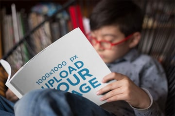 Open Square Book Mockup of Boy Reading
