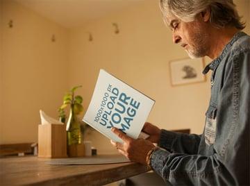 Square Book Mockup of Elderly Man Reading