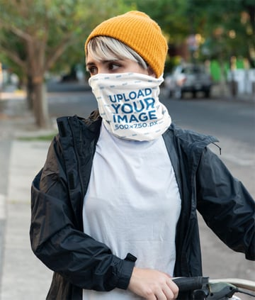 Neck Gaiter Mockup of a Young Woman Covering Her Face on the Street