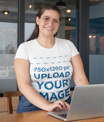 Plus Size T-Shirt Mockup of Woman Using Her Laptop