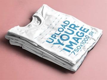 Folded T-Shirts Mockup Over a Flat Backdrop