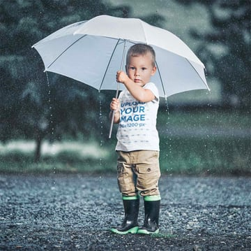 Baby T-Shirt Mockup of a Little Boy Standing in the Rain