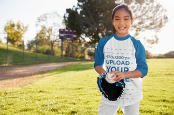 Three-Quarter Sleeve Kids T-Shirt Mockup of a Girl Playing Baseball for Fun