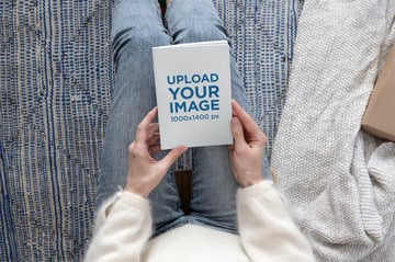Book Mockup Generator of a Woman in a Cozy Setting