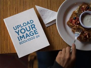 Paperback Book Mockup at Breakfast