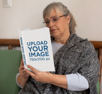 Book Mockup Generator of an Adorable Granny Reading a Book