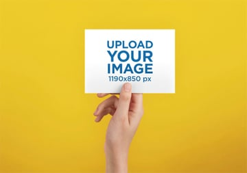 A6 Postcard Mockup Template Against a Solid Color Surface