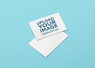 Postcard Design Mockup Featuring a Customizable Backdrop