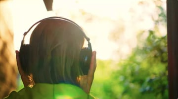 Girl Listening To Music In Headphones Outdoor