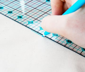 Trace a line onto your fabric with a transfer pen