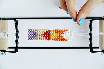 Go through the second and third bead