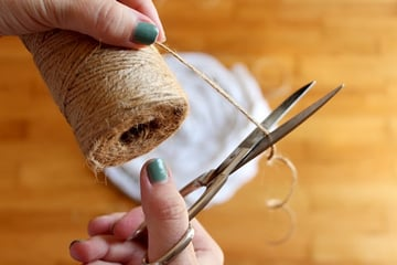 cut off a long piece of twine
