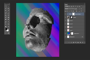 Create a clipping mask on the black and white layer to be applied only on the statue image